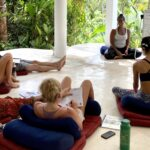 Yoga class in bali watching teacher
